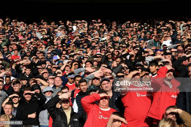 Manchester United fans shield their eyes from the bright sunshine during the Premier League match between Leicester City and Manchester United at The...