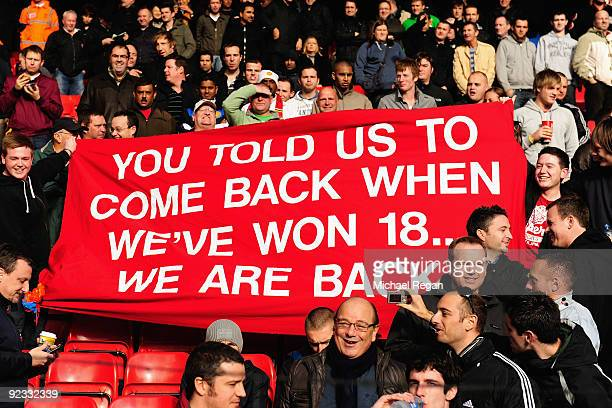 Manchester United fans show off a banner during the Barclays Premier League match between Liverpool and Manchester United at Anfield on October 25...