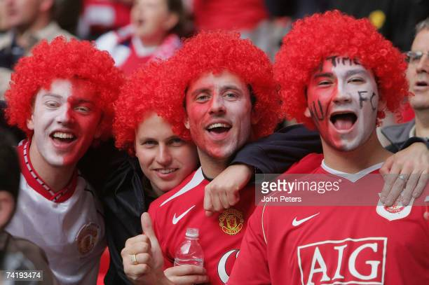 Manchester United fans watch from the stand during the FA Cup Final sponsored by E.ON between Manchester United and Chelsea at Wembley Stadium on May...