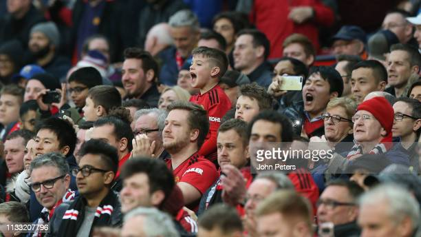 Manchester United fans watch from the stand during the Premier League match between Manchester United and Southampton FC at Old Trafford on March 02...