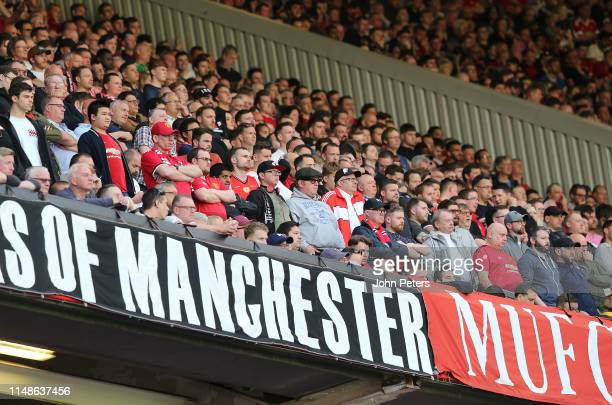 Manchester United fans watch from the stand during the Premier League match between Manchester United and Cardiff City at Old Trafford on May 12 2019...