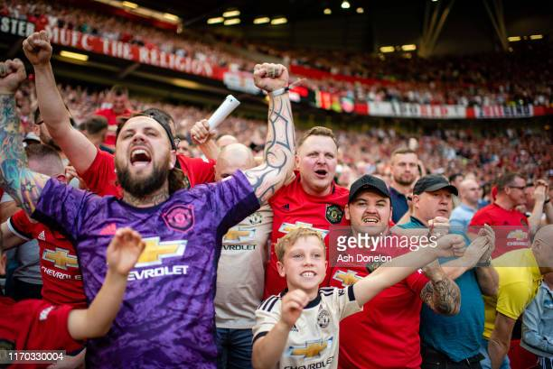 Manchester United fans watch from the stand during the Premier League match between Manchester United and Crystal Palace at Old Trafford on August 24...