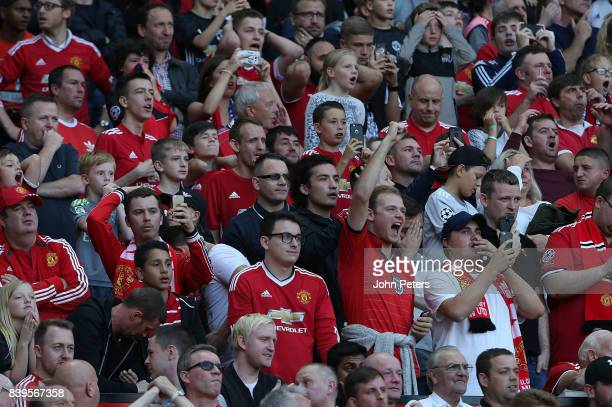 Manchester United fans watch from the stand during the Premier League match between Manchester United and Leicester City at Old Trafford on August 26...