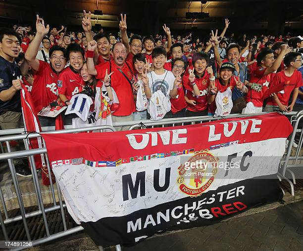 Manchester United fans watch from the stand during the preseason friendly match between Kitchee FC and Manchester United as part of their preseason...