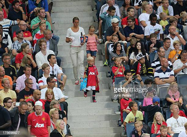Manchester United fans watch from the stand during the preseason friendly match between AIK Fotboll and Manchester United at Friends Arena on August...