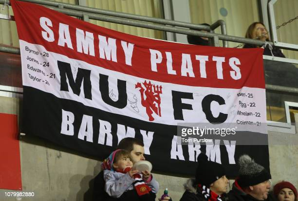 Manchester United fans watch from the touchline during the FA WSL Cup match between Manchester United Women and West Ham United Women at Leigh Sports...