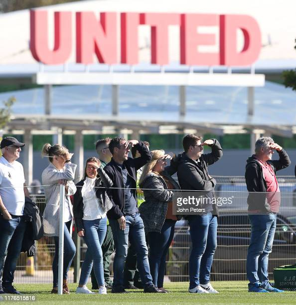 Manchester United fans watch from the touchline during the U18 Premier League match between Manchester United U18s and Everton U18s at Aon Training...