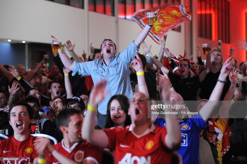 Manchester United fans watch the Champions League Final on the big screens inside Lancashire Cricket Club, Old Trafford, Manchester.
