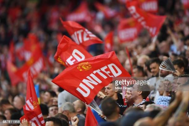 Manchester United fans wave flags prior to the UEFA Europa League Final between Ajax and Manchester United at Friends Arena on May 24 2017 in...
