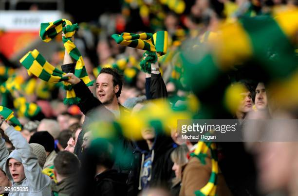 Manchester United fans wave yellow and green scarves during the Barclays Premier League match between Manchester United and Portsmouth at Old...