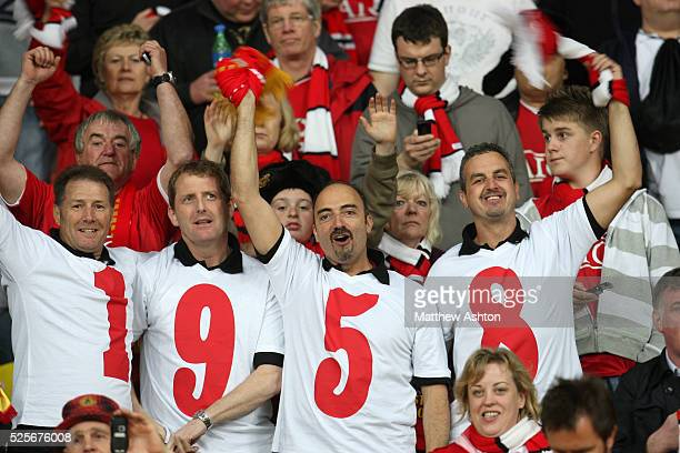Manchester United fans wearing Tshirts spelling out 1958 at the 2008 final in Moscow 50 years since the Munich Air Disaster where members of the...