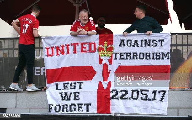 Manchester United fans with a banner reading 'United Against Terrorism Lest We Forget' in memory of the victims of the Manchester Arena attacks...