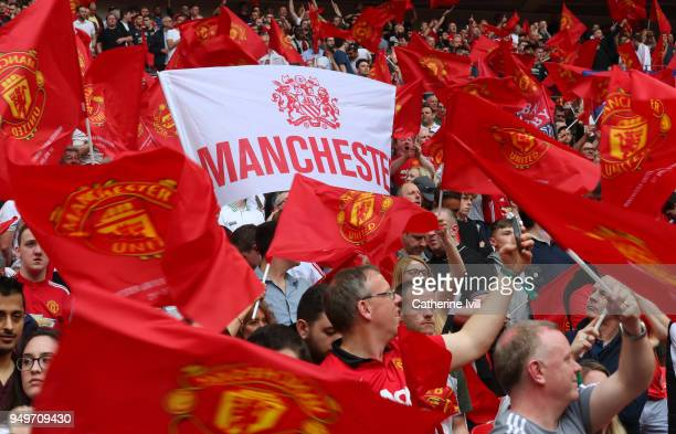 Manchester United fans with flags and banners during The Emirates FA Cup Semi Final between Manchester United and Tottenham Hotspur at Wembley...