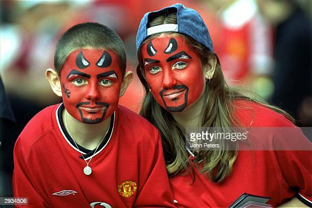 Manchester United Fans with painted devil faces prior to kick off in Bayern Munich Centenary Tournament in August 2000