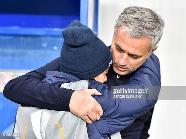 TOPSHOT Manchester United FC coach Jose Mourinho hugs a young fan prior the UEFA Europa League football match between FC Zorya Luhansk and Manchester...