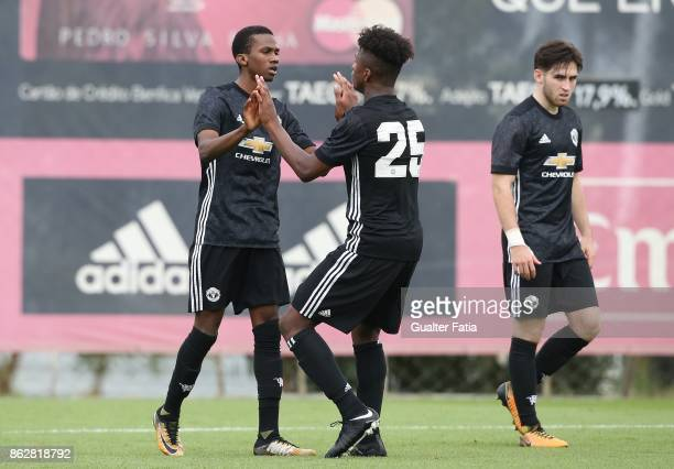 Manchester United FC forward Joshua Bohui celebrates with teammate Manchester United FC defender Ethan Laird after scoring a goal during the UEFA...