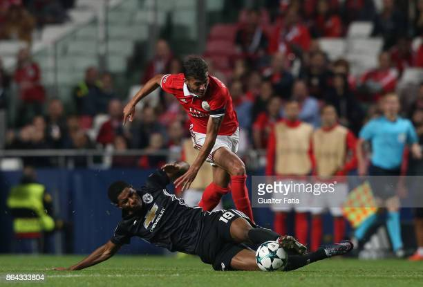 Manchester United FC forward Marcus Rashford from England tackled by SL Benfica forward Diogo Goncalves from Portugal during the UEFA Champions...