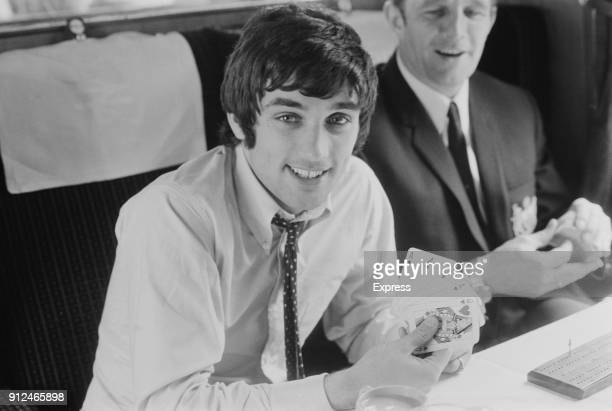 Manchester United FC soccer player George Best plays poker on a train, UK, 27th May 1968.