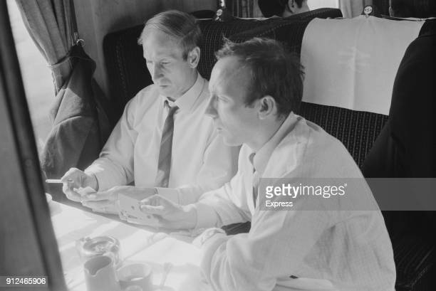 Manchester United FC soccer players Bobby Charlton and Nobby Stiles playing poker on a train 27th May 1968