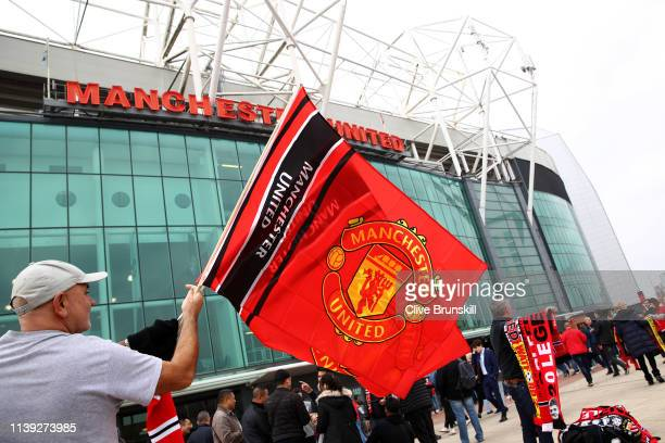 Manchester United flags are seen for sale outside the stadium prior to the Premier League match between Manchester United and Watford FC at Old...