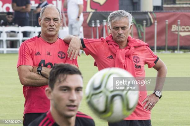 Manchester United Football Club technical coach Silvino Louro left and manager Jose Mourinho watch their squad as they train at Barry University in...