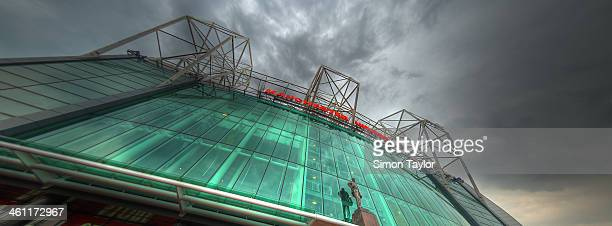 Manchester United football stadium / ground at Old Trafford, showing the statue of sir Matt Busby at the from entrance.