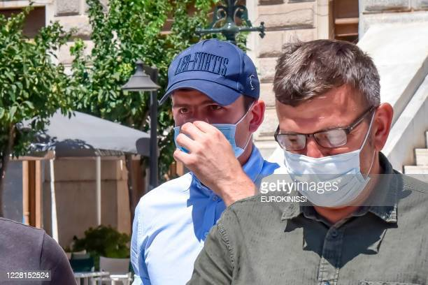 Manchester United football team captain Harry Maguire leaves a courthouse on the Greek island of Syros, the administrative hub of the Cycladic island...