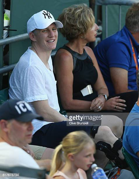 Manchester United footballer Bastian Schweinsteiger who is not playing due to a leg injury watches his girlfriend Ana Ivanovic of Serbia in action...