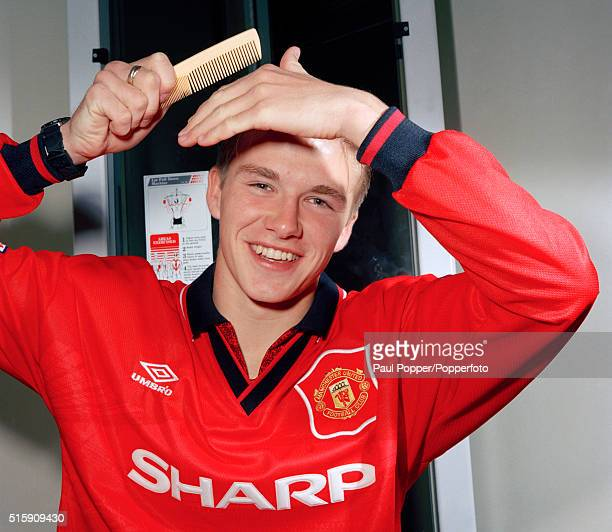 Manchester United footballer David Beckham combing his hair at Old Trafford in Manchester circa 1996