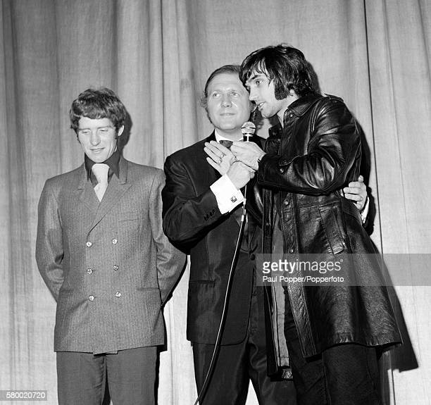 Manchester United footballer George Best and Everton's Alan Ball on stage with presenter and broadcaster Stuart Hall during a Charity event in...