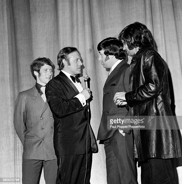 Manchester United footballer George Best and Everton's Alan Ball on stage with presenter and broadcaster Stuart Hall who is interviewing Liverpudlian...