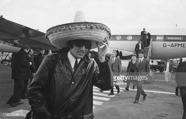 Manchester United footballer George Best arrives back at London Airport wearing a large sombrero after his team's 51 victory over Benfica in a...