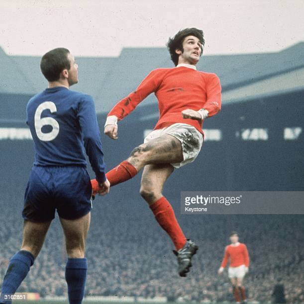 Manchester United footballer George Best jumps to head a ball watched by a Chelsea player