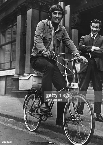 Manchester United footballer George Best tries out his new bicycle after receiving a six month driving ban from a Manchester court.