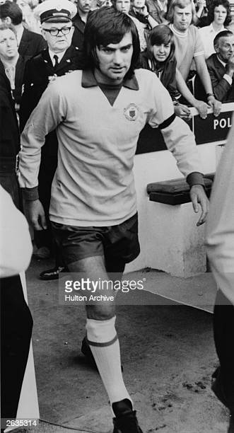 Manchester United footballer George Best walks out onto the pitch