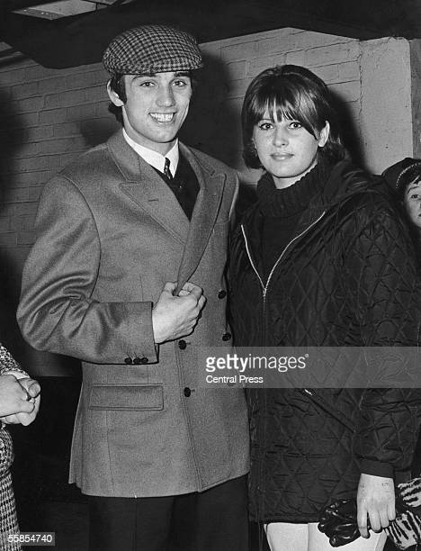 Manchester United footballer George Best with his girlfriend after a match at Old Trafford, 26th April 1965. Man U had just defeated Arsenal 3-1 to...