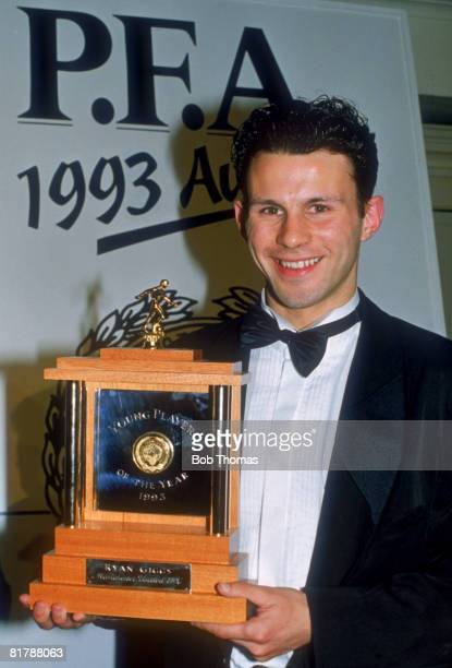 Manchester United footballer Ryan Giggs wins the Young Player of the Year trophy at the PFA Awards in London 28th March 1993