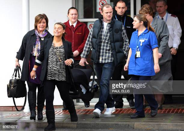 Manchester United footballer Wayne Rooney and his wife Coleen leave Liverpool Women's Hospital in Liverpool, north-west England, on November 3, 2009....