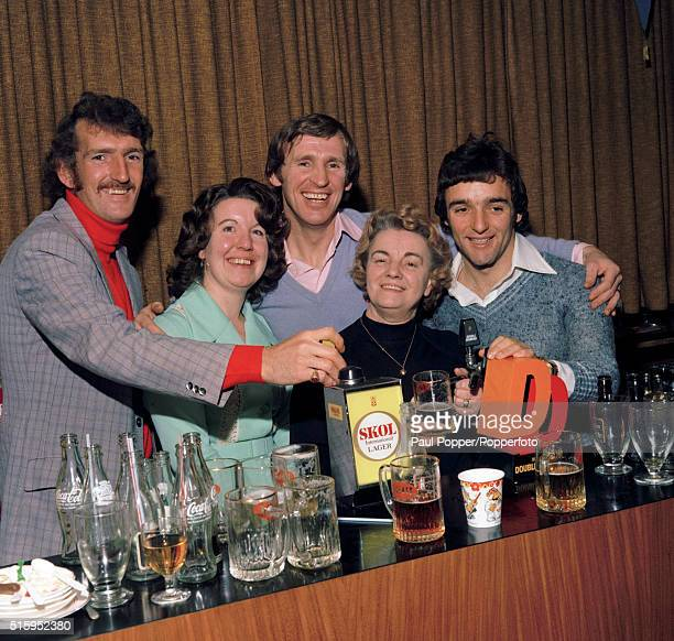 Manchester United footballers Alex Stepney Pat Crerand and Lou Macari during the club's Christmas party at Old Trafford in Manchester circa December...