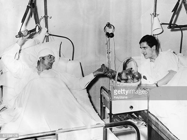 Manchester United footballers Dennis Viollet and Albert Scanton share a basket of fruit in their ward at Isar Hospital Munich after the air crash...