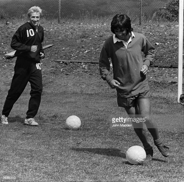 Manchester United footballers George Best and Denis Law in training