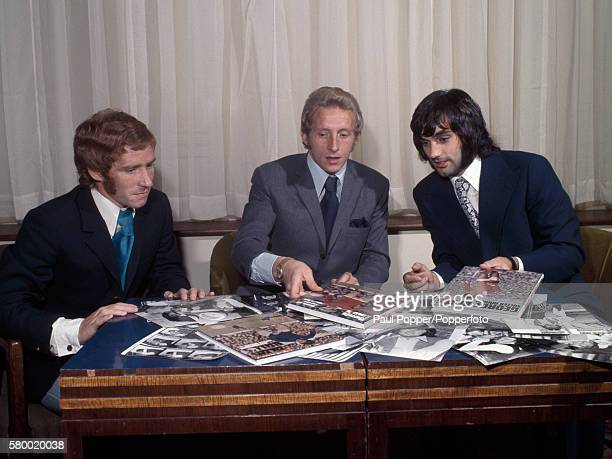 Manchester United footballers George Best and Denis Law with Everton's Alan Ball at the launch of their Christmas football books in Manchester circa...