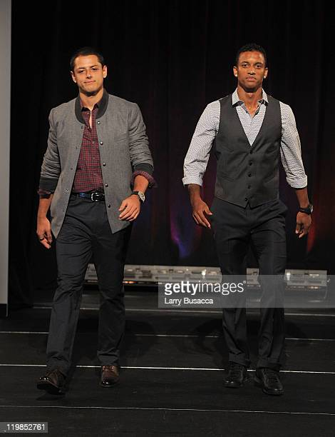Manchester United footballers Javier 'Chicharito' Hernandez and Nani walk the runway during Hublot Art of Fusion fashion show with Sir Alex Ferguson...