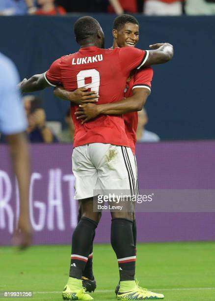 Manchester United forward Marcus Rashford celebrates with Romel Lukaku after scoring in the first half against Manchester City in the first half at...