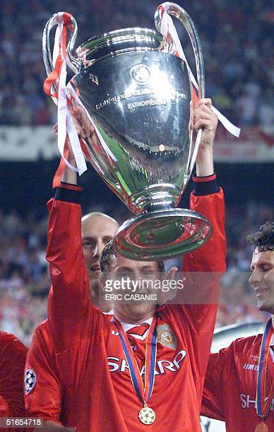 Manchester United forward Ole Gunnar Solskjaer holds the Cup 26 May 1999 at the Camp Nou Stadium in Barcelona after winning the soccer final...