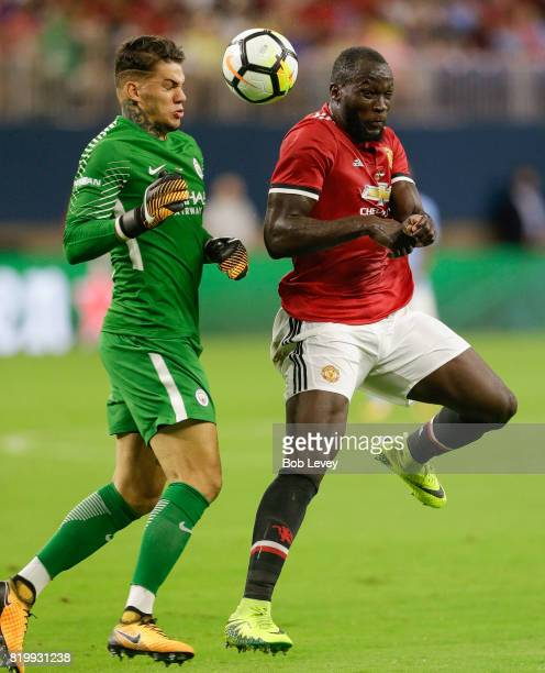 Manchester United forward Romelu Lukaku heads the ball past goalkeeper Ederson Moraes and then scores in the first half at NRG Stadium on July 20...