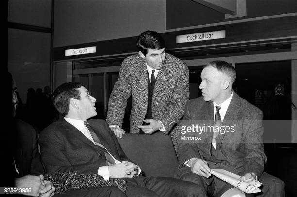 Manchester United full back Tonny Dunne chats with Liverpool manager Bill Shankly and winger Ian Callaghan at Ringway Airport before the Liverpool...