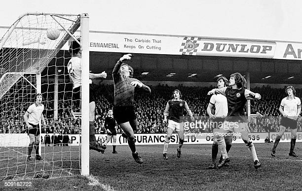 Manchester United goalkeeper Alex Stepney and fullback Alex Forsyth are beaten as the ball goes into the top corner for one of Aston Villa's two...