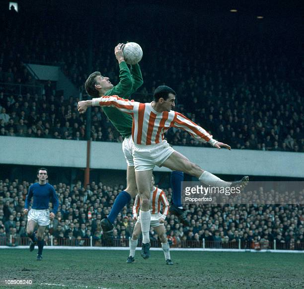 Manchester United goalkeeper Alex Stepney catches the ball under pressure from Roy Vernon of Stoke City during their Division One match played at the...