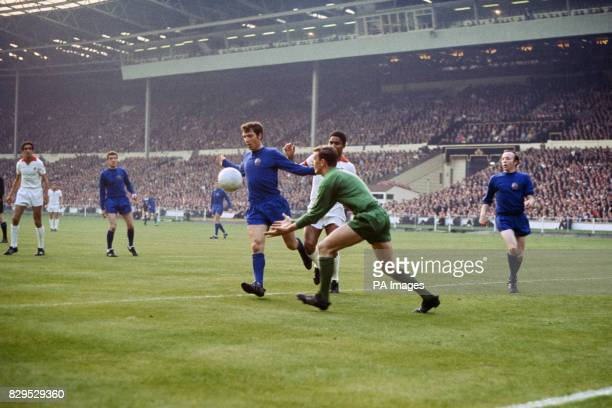 Manchester United goalkeeper Alex Stepney comes out to collect the ball as teammate David Sadler holds off Benfica's Eusebio watched by United's...
